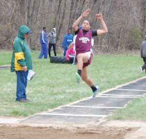 Naugatuck's Chris Quarles competes in the long jump during a track meet Tuesday versus Holy Cross, Crosby and St. Paul in Waterbury. Naugatuck won the boys and girls meet. –KEN MORSE