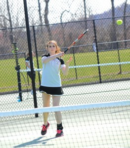 Woodland junior Julia Lawton returns a shot Monday afternoon during a match against Wolcott in Beacon Falls. The Hawks beat the Eagles, 6-1. Lawton won her match, 8-5. –LUKE MARSHALL