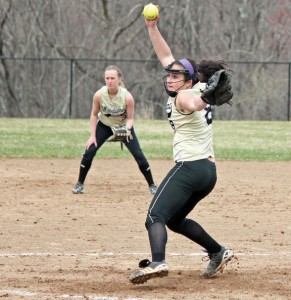 Woodland's Samantha Lee winds up to deliver a pitch as Stephanie Kiley settles in at shortstop Monday morning versus Wolcott in Beacon Falls. The Hawks won, 8-0. Lee allowed two hits and had seven strike outs in the game. –ELIO GUGLIOTTI