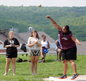 Naugatuck's Brianna Ritter hurls the shot put at the NVL girls track and field championships Tuesday in Beacon Falls. Ritter finished third in the shot put and took first place in the discus with a throw of 101 feet, 9 inches. The Naugatuck girls tied for third with Holy Cross at the meet. –LUKE MARSHALL