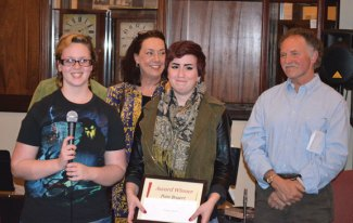 Naugatuck resident Natalie Johnson, front right, receives the Pam Bogert Memorial Award for her expressive photography work from Madison Sumpf, Bogert's daughter, front left, April 25 during the Naugatuck Historical Society's 5th Annual Celebration of Art at the museum on Water Street in Naugatuck. This year's show was dedicated to Bogert, a friend of the society. Four top awards were given to Irene Benardzyk, Kiki Michalek, Stephen Sherwood and Roberta Danza. The art work was judged by Tony Falcone, back right, Anne Siefert, back center, and Marianna Hanley. –CONTRIBUTED