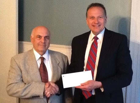 Executive Director of St. Vincent DePaul Mission of Waterbury, Inc. Paul Iadarola, left, shakes hands with President and CEO of Naugatuck Savings Bank Charles Boulier III. The Naugatuck Savings Bank Foundation recently awarded grants totaling $10,000 to the St. Vincent DePaul Mission to support its soup kitchen, food pantry and shelter programs. One $5,000 grant was awarded to the mission's soup kitchen and food pantry program. The soup kitchen prepares and serves over 140,000 cooked meals each year. In addition, the food pantry provides bagged groceries twice week — an equivalent to nearly 200,000 meals annually. Another $5,000 grant was awarded to the mission's 126-bed shelter. An average of 80 single adults and eight families with children find refuge at the shelter each night. The grant will help provide for staffing the shelter day program for women, women with children, utilities, equipment, supplies, and food. 'We are grateful for Naugatuck Savings Bank Foundation's generous support for our programs,' Iadarola said. –CONTRIBUTED
