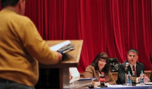Naugatuck Mayor Robert Mezzo, right, and Board of Finance Chairman Diane Scinto respond to a question from John Dibiaso during a public hearing on the budget Monday night in the auditorium of City Hill Middle School. –ELIO GUGLIOTTI