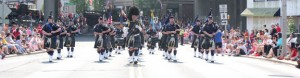 The Police Pipes and Drums Corps of Waterbury march on Maple Street during Naugatuck's 2012 Memorial Day parade. –FILE PHOTO