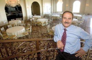 Joe Geloso Sr. stands on a staircase overlooking a grand ballroom at Aria Wedding and Banquet Facility in Prospect. –RA ARCHIVE