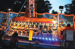 The Ali Baba ride elicits screams of pleasure and fear from riders during the St. Francis-St. Hedwig School's carnival in Naugatuck last June.-FILE PHOTO