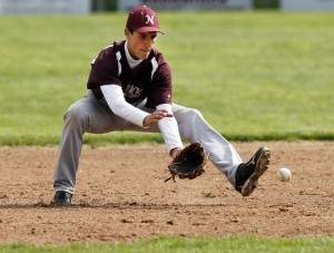 Naugatuck's Jason Bradley fields a grounder against Kennedy Wednesday afternoon at Rotary Field in Naugatuck. The Greyhounds fell to the Eagles, 4-3, but clinched a trip to the state tournament with a win over Crosby on Tuesday. –RA ARCHIVE