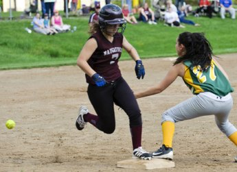 Naugatuck's Kara Klimaszewski beats the throw to first as Holy Cross' Gianna Lagasse defends the base Monday afternoon during the quarterfinals of the NVL softball tournament in Waterbury. The Greyhounds fell to the Crusaders, 8-3. –RA ARCHIVE