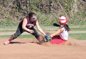 Naugatuck's Gillian Fortier tags out Derby's Shelby Mendillo at third May 1 at Breen Field in Naugatuck. The Greyhounds won, 11-0. –ELIO GUGLIOTTI