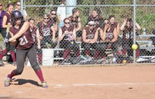 Naugatuck's Sarah Chandler sizes up a pitch May 1 versus Derby at Breen Field in Naugatuck. The Greyhounds won, 11-0. –ELIO GUGLIOTTI