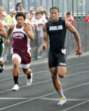 Woodland's Rahmi Rountree, right, edges out Naugatuck's Mick Pernell in the 100 meter dash during the NVL boys track and field championship meet Tuesday in Beacon Falls. Woodland won the meet with 131.5 points as Naugatuck finished fifth with 61.5 points. –LUKE MARSHALL
