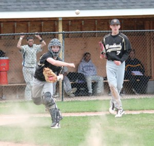 Woodland catcher Mike Gondola throws to first for an out as pitcher Tanner Kingsley (7) looks on Monday afternoon versus Kennedy in Beacon Falls. The Hawks battled back from a 2-0 deficit to win the game, 10-5. –ELIO GUGLIOTTI