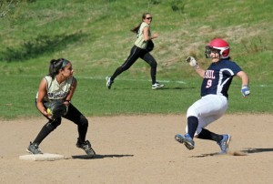 Woodland's Brooke Leshin gets the force out at second and tries to turn the double play May 2 versus St. Paul in Beacon Falls. Woodland won the game, 6-0. –ELIO GUGLIOTTI