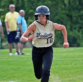 Woodland's Natalie Veneri comes into to score Monday afternoon during the quarterfinals of the NVL softball tournament versus Wolcott in Beacon Falls. Woodland won, 9-0, but fell Tuesday in the semifinals to Seymour, 11-1. –ELIO GUGLIOTTI