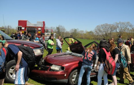 A mock crash was held at Woodland Regional High School in Beacon Falls May 3 in anticipation of tonight's senior prom. The mock crash was put on as part of Makenzie White's senior project. During the simulation members of Beacon Hose Company No. 1 and the police department arrived on the scene of a mock three-car crash on the soccer field and extracted students from the cars. White said she thought the mock crash was important because it showed the students that they are not as invincible as they think they are. –PHOTOS BY LUKE MARSHALL