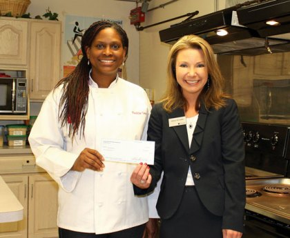 Kashia Cave, left, chef, founder and executive director of My City Kitchen in Meriden, receives a $5,000 grant from Lilliana McAuliffe, Naugatuck Savings Bank Meriden branch manager. The Naugatuck Savings Bank Foundation awarded the grant to My City Kitchen to support its afterschool and summer programs to help children adopt healthy eating habits, improve self-esteem, and become physically fit. 'We are grateful for the foundation's generous grant that will help us reach more children. Our students magnify the effect of our program by taking the lessons they learn home, influencing the lives of their families,' Cave said. -CONTRIBUTED