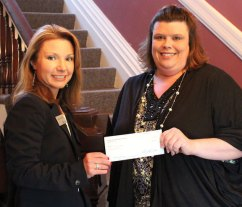 Lilliana McAuliffe, branch manager of Naugatuck Savings Bank's Meriden branch, left presents a $5,000 grant to Michelle Bourdeau, executive director of Girls Incorporated of Meriden. The Naugatuck Savings Bank Foundation awarded the grant to support the expansion of programs into Wallingford specific just for girls ages 6 to 18. Girls Incorporated is an all-girl environment that guides young women through self-discovery with program based curriculum. 'We are thankful for the foundation's generous grant that will help us reach more girls and help them reach their full potential,' said Bourdeau. -CONTRIBUTED