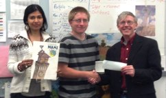 Naugatuck High School sophomore Ryan Russett won the 3rd Annual T-Shirt Drawing Contest for the NAMI Walk. Russett won the grand prize with his design of the Republican-American clock tower with brains pushing the American flag to the top to show how they are overcoming the stigma of mental illness. Pictured, NAMI Treasurer John Henebry, right, presents Russett with the grand prize as Naugatuck High art teacher Hamandrawatee Pertab holds up Russett's winning design. NAMI Waterbury will again be running the T-Shirt Contest beginning in September this year. Any school that would like to participate can contact Kim Pernerewski at (203) 578-5447. -CONTRIBUTED