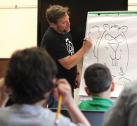 Syndicated cartoonist Rick Stromoski shows children how to draw a cartoon squirrel during a How to Cartoon program June 12 at the Prospect Library. About two dozen children attended the program and learned how to draw a variety of cartoons. –ELIO GUGLIOTTI