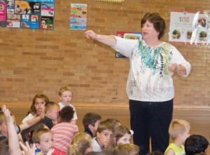 Hop Brook Elementary School Principal Evelyn Gobstein calls on a student during an assembly at the school in Naugatuck Monday. Gobstein, who has worked 36 years as an educator, is retiring. –LUKE MARSHALL