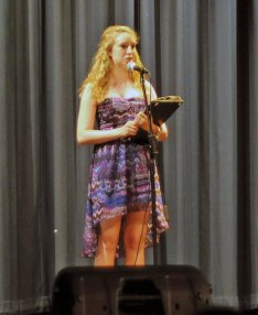 Woodland Regional High School student Casey Stevens addresses the audience before the start of Woodland's Got Talent June 11. The show was organized by Stevens as part of her senior project. 'It's to display and showcase the talents of the students, faculty, and teachers here at Woodland, Stevens said. The show featured 30 acts, including music, acting, magic and a dramatic reading. Stevens, who volunteers at Prospect Youth Services, said that the youth services hosts a talent night for elementary school students. 'Other than fine arts nights we don't really have a talent opportunity for students to partake in,' Steven said. –LUKE MARSHALL