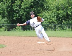 Steve Kazalunas of Posts 194-25 dives as he throws to first base to try to get the out last season. The Posts are starting a Junior Legion program this year. –FILE PHOTO