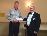 Naugatuck Elks Lodge Exalted Ruler Dave Perugini presents a $1,000 donation to Naugatuck High School Grad Nite committee member Tom Louth recently. The donation was made through the Elks National Foundation Gratitude Grant Program. –CONTRIBUTED