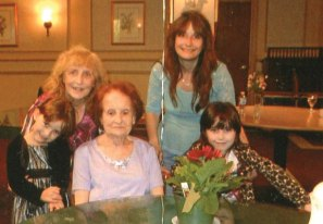 Four generations of the Traver family of Naugatuck came together on Mother's Day at the Highland Health Care Center. Pictured Adeline Triano, center, great-grandmother, poses for a picture with her family, Kitty Taver, left, Julie Lucia, right, and twins Jennifer and Jessica Lucia. –CONTRIBUTED