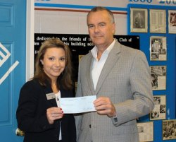 Lilly McAuliffe, Naugatuck Savings Bank Meriden branch manager, presents a $5,950 grant to Larry McGoldrick, Boys & Girls Club of Meriden executive director to fund a new capacity building registration management system for the club. 'We are grateful for the foundation's generous grant that will help us strengthen our internal operating structure to be more effective and efficient while working toward fulfilling our mission,' said McGoldrick in a press release. –CONTRIBUTED