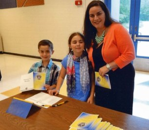 Naugatuck resident Joan McCasland, a third-grade teacher at Chatfield-LoPresti Elementary School in Seymour, was named Seymour Teacher of the Year for 2012-13. McCasland is pictured with her children Zoey and Zachary. –CONTRIBUTED