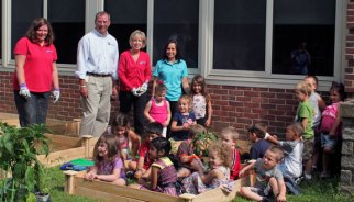 Children from Naugatuck's Head Start/School Readiness Program, with the help of volunteers from Naugatuck Valley Savings and Loan, built raised garden beds and planted vegetables Friday at Central Avenue Preschool. –ELIO GUGLIOTTI