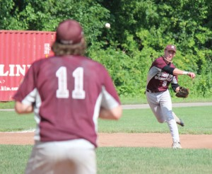 Post 17's Adam Neveski (9) throws to first baseman Seth Mulhall for an out against Danbury Sunday afternoon at Rotary Field in Naugatuck. Post 17 won the game, 1-0. –ELIO GUGLIOTTI