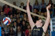 Woodland's Samantha White hits the ball over the net during the CIAC Class M championship against Ledyard in East Haven. It was the first time in school history the volleyball team made the state final. –RA ARCHIVE