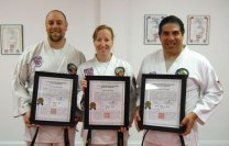 Sokol's Taekwondo students Dave Grenier, Leah Grenier and Ted Lanzaro and Elaine Abrantes were recently promoted to first degree Black Belts. -CONTRIBUTED