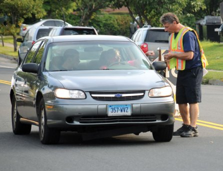 Naugatuck firefighter David Christoff collects money for the Muscular Dystrophy Association on Maple Street and Old Fire House Road Aug. 22. –LUKE MARSHALL
