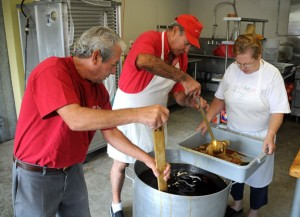 Naugatuck Portuguese Club members from left Armando Rodrigues, Fred Valente and Maria Emador prepares eels Thursday morning at the club on Rubber Avenue for the 63rd annual Feast of Sao Paio Festival, which begins on Friday. The club bought and prepared 800 pounds of eels for the festival.  –LUKE MARSHALL