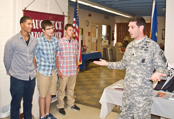U.S. Army Recruiting Battalion Albany Battalion Commander Lt. Col. Michael Coleman recognizes Naugatuck teens, from left, Richard Brito, Jensen Mezzio and Nick Ryan Aug. 6 at the Naugatuck Senior Center for their service work at the center this summer. –LUKE MARSHALL