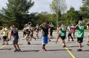 The Naugatuck High School marching band practices in the parking lot at City Hill Middle School in Naugatuck Wednesday afternoon. The students have been practicing at the middle school while Naugatuck High School is undergoing renovations. –RA ARCHIVE
