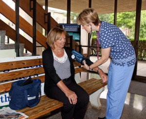 Rhonda Lord, R.N., for the Visiting Nurses Association checks the blood pressure of Leslie Mazur of Naugatuck during a blood pressure clinic held at the Naugatuck Town Hall Aug. 1. A strategic planning report has recommended the borough privatize the VNA and Youth and Family Services. –RA ARCHIVE