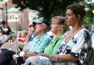 Beth Profeta, right, listens to a vigil for Waterbury resident William Smolinski Jr., who has been missing for 10 years. The vigil on the Naugatuck Town Green last year was dedicated to missing persons. Profeta's mother, Mary Baderacco, is also missing. –RA ARCHIVE