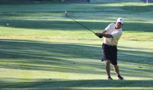 Glenn Petelle swings from the fairway on the first hole during the finals of the Hop Brook Golf Championship at Hop Brook Golf Course in Naugatuck Sunday morning. –ELIO GUGLIOTTI