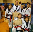 Six members of USA Martial Arts in Naugatuck earned a black belt on Sept. 13 at a Cheezic Tang Soo Do Karate grading held at the Waterbury Boys Club. Pictured, kneeling, Karli Butcher and Lauren Mulinski, standing, Nicholas Mercure, Emil Lizak, Nathaniel Smith and Noah Santoro. -CONTRIBUTED