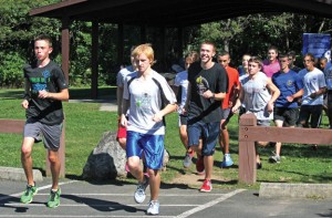 Naugatuck High junior Dan Schumacher (front left) and freshman Grady Beasley (front right) lead the boys cross country team on a run during practice Sept. 6 at Hop Brook State Park in Middlebury. -ELIO GUGLIOTTI