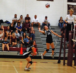 Naugatuck's Stefani Barry (34) goes for the kill Tuesday night at home against Torrington as Kait Barry (24) backs her up. The Greyhounds fell to the Red Raiders, 3-1. –KEN MORSE