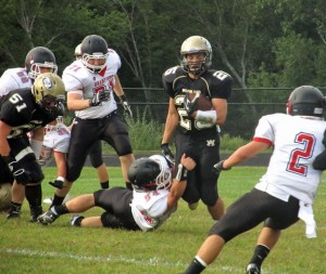 Woodland's Coby Vaccarelli (25) sheds a tackle Sept. 13 against Branford in Beacon Falls. Vaccarelli racked up 81 yards on the ground in 11 attempts as the Hawks topped the Hornets, 44-19. –KYLE BRENNAN