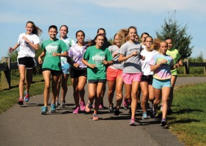 The Woodland girls cross country team practices at the high school Sept. 6. –LUKE MARSHALL