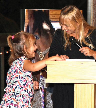 Hidden Acres Therapeutic Riding Center held its second annual Night of Caring fundraiser Sept. 20 at the The Lodge in Bethany. Parent Tracey Conway spoke at the program about how beneficial the program has been for her daughter Colleen (pictured above), who was born with Angelman Syndrome. Hidden Acres is a non-profit program located in Naugatuck, which focuses on improving the minds, bodies and spirits of children and adults with emotional, developmental and physical challenges. Hidden Acres thanked the many corporate sponsors and local businesses for their donations and support making the Night of Caring a success. For more information, visit www.hiddenacrestrc.org. –CONTRIBUTED