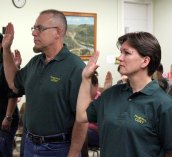 Robert Smith, left, and Suzanna Sedenszki are sworn in as members of Naugatuck's Community Emergency Response Team Monday night in Town Hall. In total, 19 new members of the volunteer group were sworn in during the ceremony. –ELIO GUGLIOTTI