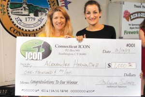 Naugatuck High School senior Alex Hernandez, 17, right, is presented a prize check for $1,000 from Connecticut Icon organizer Melissa Ericksen. Hernandez won first place in the singing competition, which was held during the Southington Apple Harvest Festival earlier this month. –CONTRIBUTED