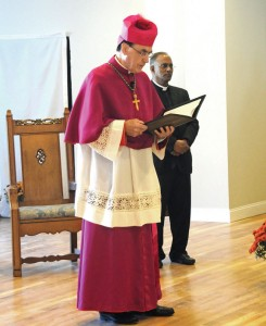 Archbishop Henry Mansell of Hartford addresses the parish of St. Francis Church in Naugatuck during a rededication ceremony for the church hall Oct. 2 as Father John Kuzhikottayil looks on. –LUKE MARSHALL
